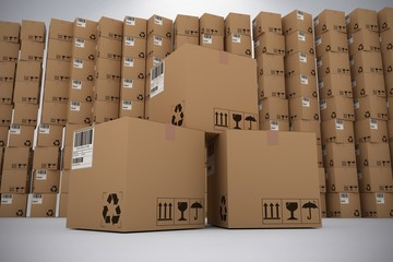 Composite image of pile of brown cardboard boxes