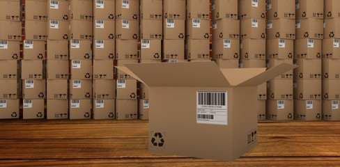 Composite image of open cardboard box by stack of boxes