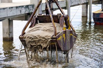 dredger bucket dredging lake bottom in marina Fototapete