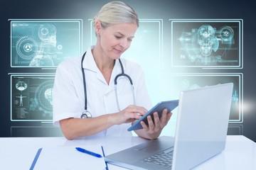 Composite 3d image of female doctor using digital tablet