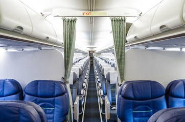 View of the interior from the business class, and view of the economy class in the plane.