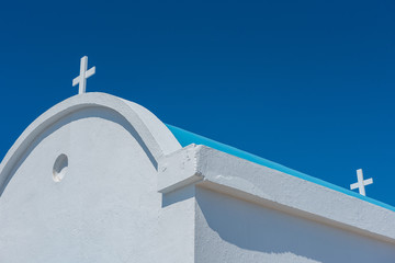 Traditional white chapel with a blue roof on the seaside. Agioi Anargyroi, Cyprus Fototapete