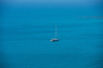 Alone yacht sailing in open sea. Travel concept