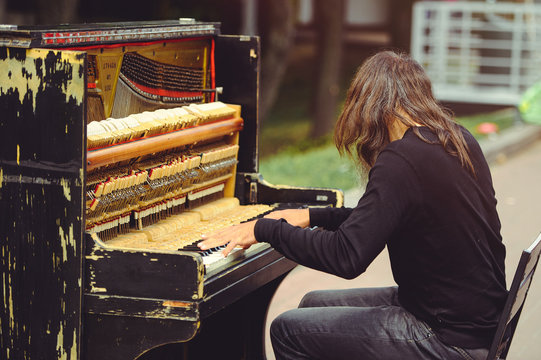Man on the street playing the piano