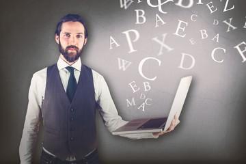 Composite image of portrait of businessman holding laptop