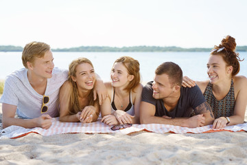 Group of happy young students on summer vacation