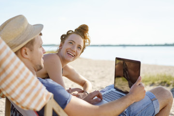Young couple enjoying a summer day at the beach