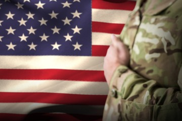 Composite image of mid section of military soldier taking oath