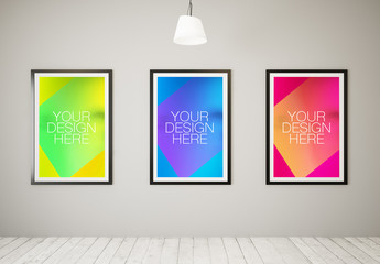 3 Large Framed Posters in White Room Mockup 1