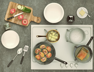 Stone countertop with gas hobs and products. Delicious eating concept with pies, fish and fresh vegetables. Top view.