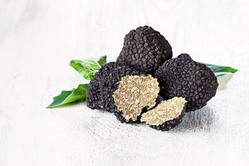 Black truffles on white background. Copy space.