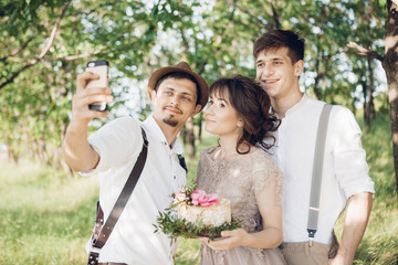 Wedding photographer, bride and groom make selfie in nature
