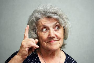 Grandmother points a finger up