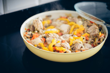 Chicken stew with mushrooms and vegetables