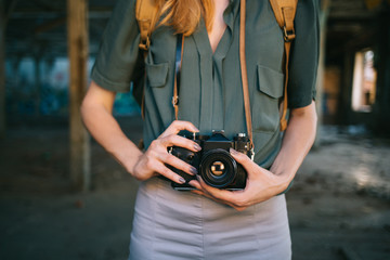 Close up of hipster woman taking photo with retro camera