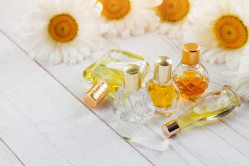 Bottles of perfume with camomile
