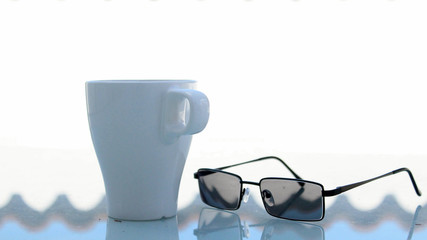 White Coffee Mug Outdoors with Modern Glasses