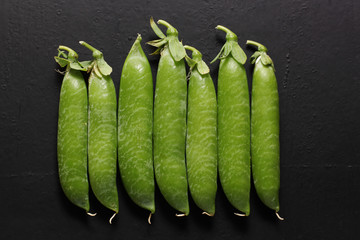 pods of pea on black background
