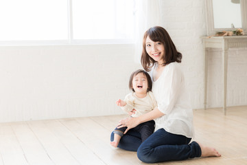 asian mother and child relaxing in living room