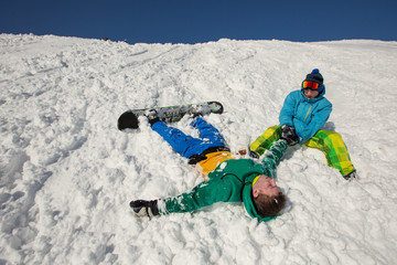 Snowboarder falling down Injured arm and get First aid in snow mountain