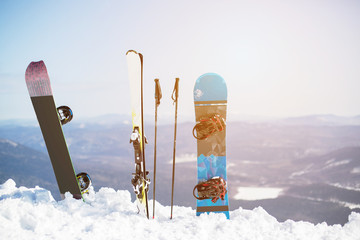 Ski and snowboard on the mountain top in snow