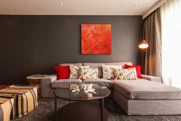 Modern living room interior with red picture on brown wall
