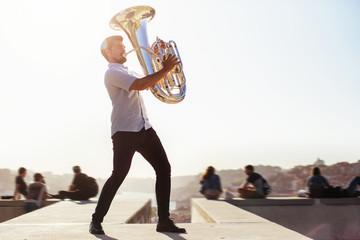 Street musician playing tuba outdoor