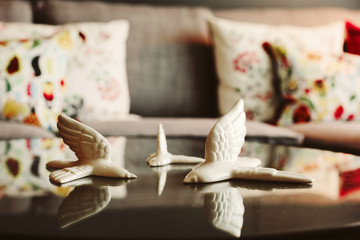 Porcelain bird in Living room interior details