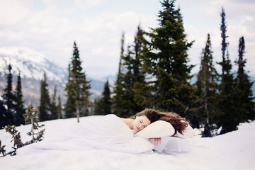 Art Portrait of beautiful woman with long brown hair slipping on the snow bad
