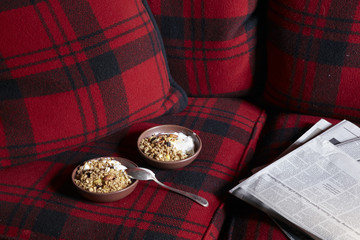 Two bowls of granola on tartan chair