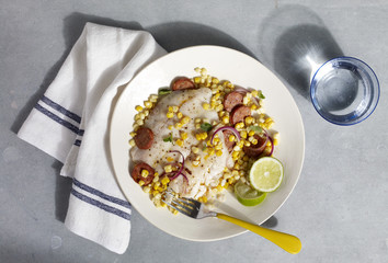 Fish corn salad on plate