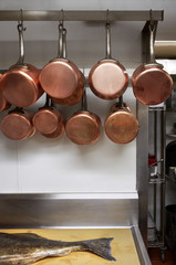 Copper pans hanging in kitchen