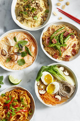 Bowls of different noodle dishes