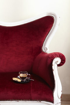 Coffee on ornate chair