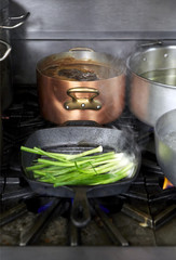 Green onions in pan in fine dining restaurant kitchen