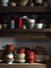 Shelves in kitchen with asian bowls