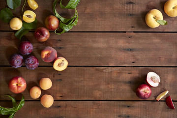 Fresh orchard stone fruit on wooden table