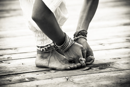 closeup of woman feet and hands in yoga postion bw