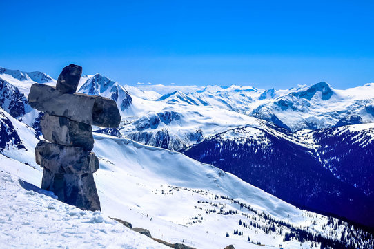 Inukshuk (inuksuk) symbol on the Whistler Blackcomb mountain in Whistler, British Columbia, Canada