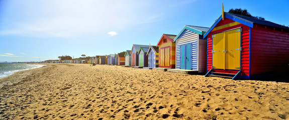 Spoed Fotobehang Australië Brighton Beach Boxes in hot sunny day
