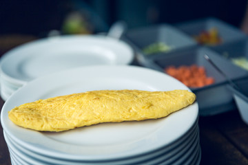 Selective focus Omelet on plate with blur cooking background and effect filter.
