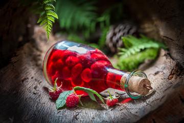 Closeup of raspberries liqueur made of fruits and alcohol Fototapete