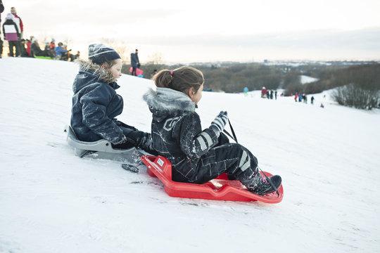 Girls riding sleds