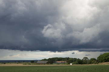Heavy dark clouds in Swedish landscape