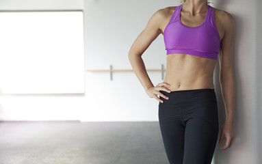 Midsection of young athlete woman