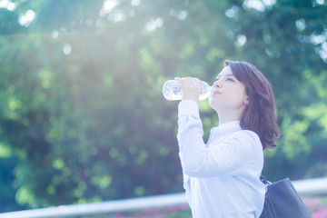 hydration concept. a young woman drinking a bottle of water.