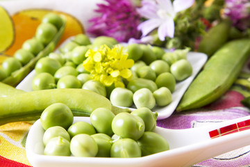 Spoon with green peas