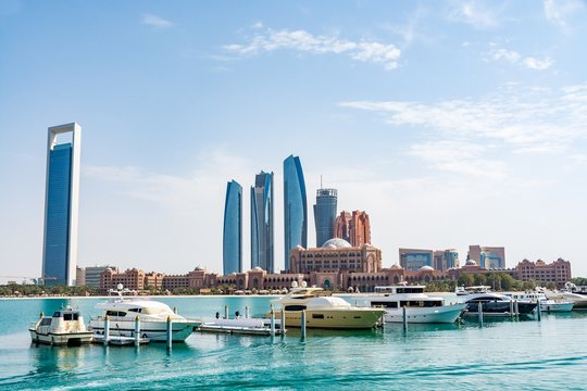 Cityscape of Abu Dhabi with the most expensive hotel in the world - the Emirates Palace Hotel, view from marina, Abu Dhabi emirate, United Arab Emirates