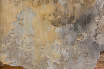 Fotobehang Oude vuile getextureerde muur Verwitterte Wand mit gelbem Anstrich