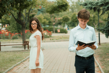 Portrait of two students with a book